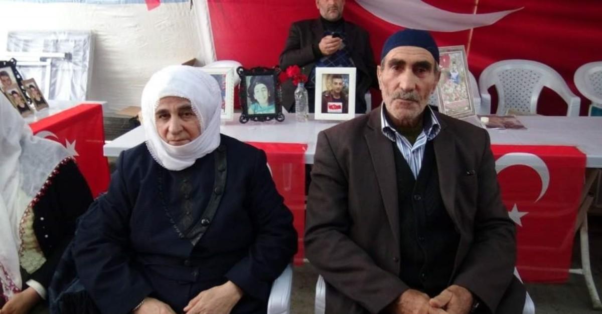 Asl?han E?refo?lu (L) and Nizamettin E?refo?lu sit alongside other families protesting the PKK terrorist organization.