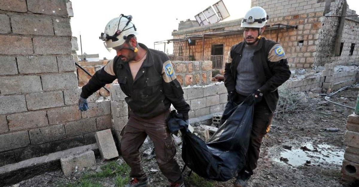 Members of the Syrian Civil Defense, also known as the White Helmets, carry the body of a victim after reported Russian airstrikes in Maar Shimmareen village in Syria's northwestern Idlib province on Dec. 16, 2019. (AFP)