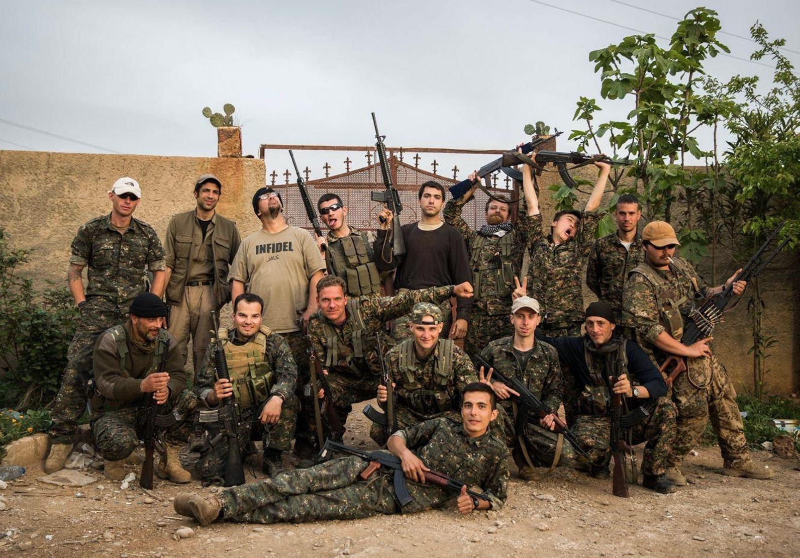 A group of foreign fighters, with YPG terrorists, pose for a photo on the outskirts of the northwestern Syrian town of Tal Tamr, April 16, 2015.