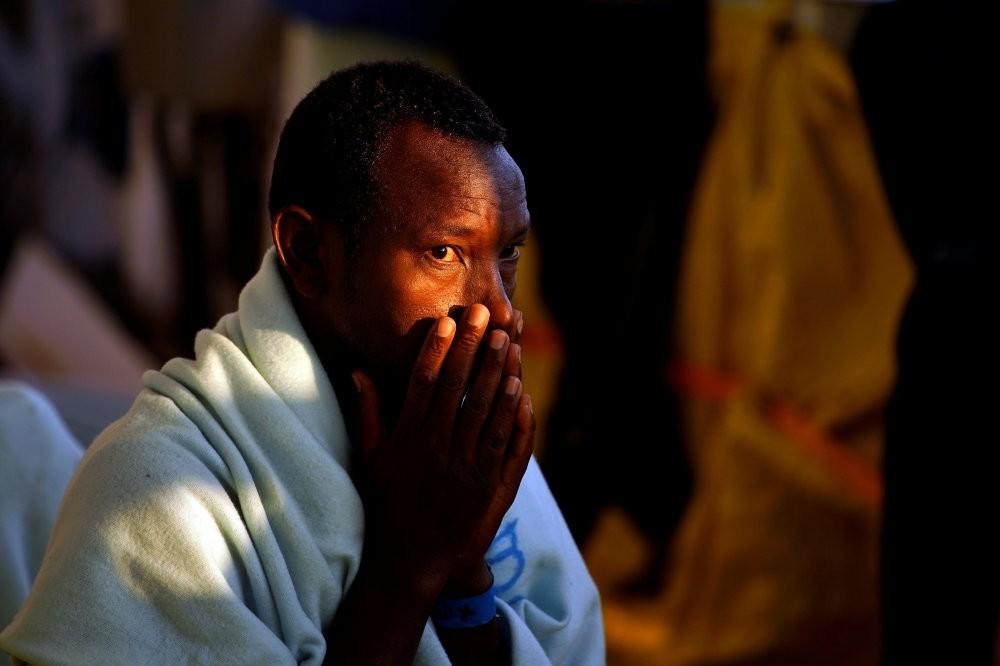 A migrant prays on a rescue boat in the central Mediterranean Sea, Aug. 6.