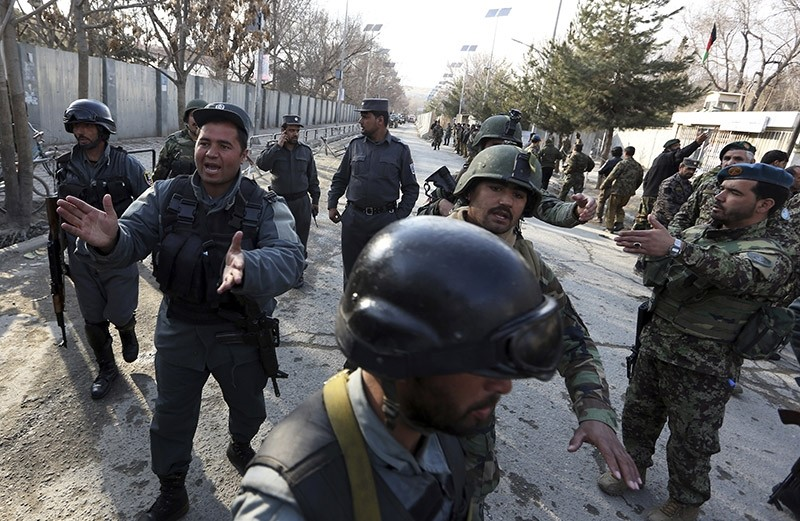 Security forces inspect the site of attack on a military hospital in Kabul, Afghanistan, Wednesday, March 8, 2017. (AP Photo)