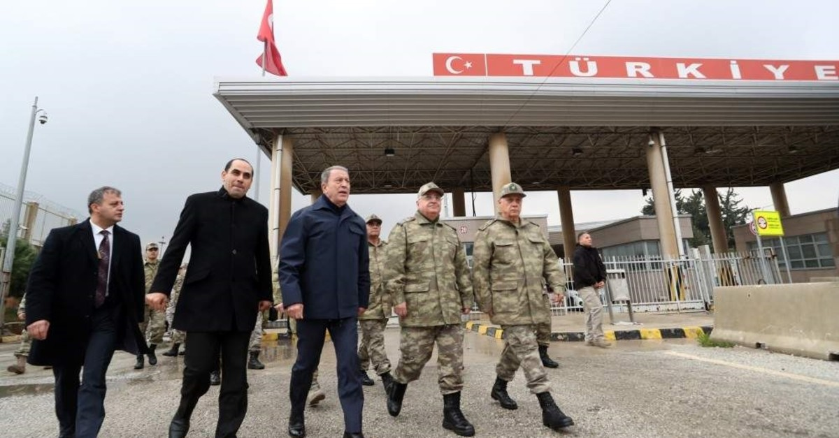 Defense Minister Hulusi Akar (middle) pictured near the Turkey-Syria border, Dec. 29, 2019. (AA Photo)