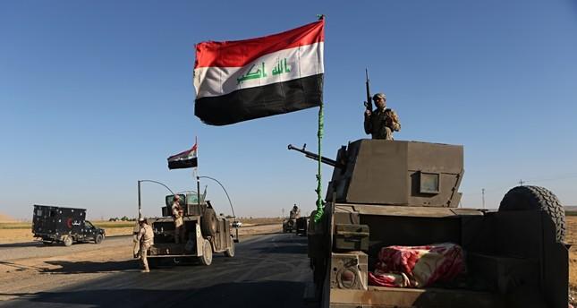 Iraqi military forces gather outside Altun Kupri, outside Irbil, Iraq, Oct. 19.