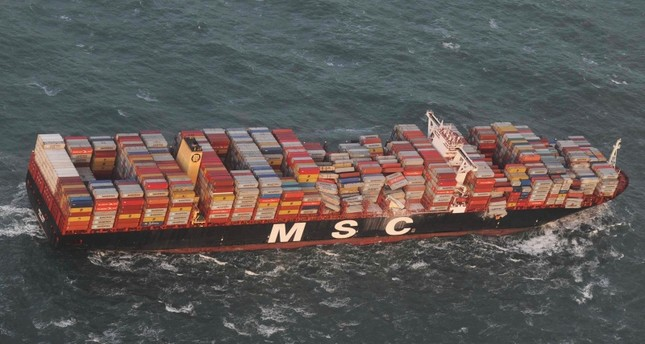 Aerial photo provided by the Central Command for Maritime Emergencies Germany shows container vessel MSC ZOE near the German North Sea island of Borkum Wednesday, Jan. 2, 2019. AP Photo