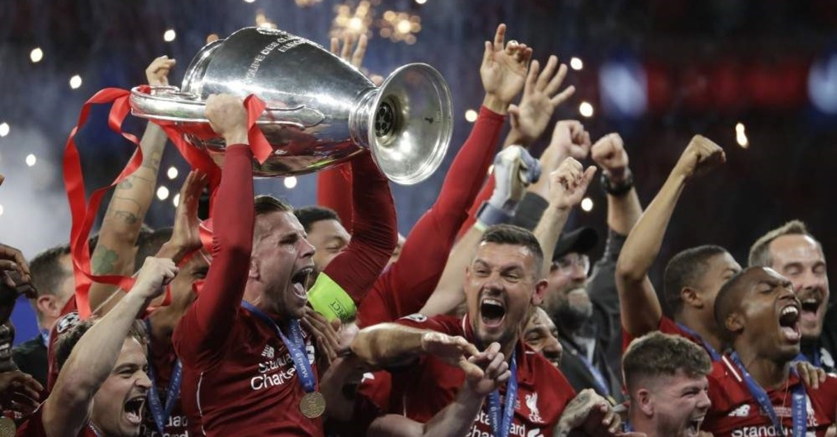 Liverpool players celebrate with the trophy after winning the Champions League final match against Tottenham Hotspur, Madrid, June 2, 2019. (AP Photo)