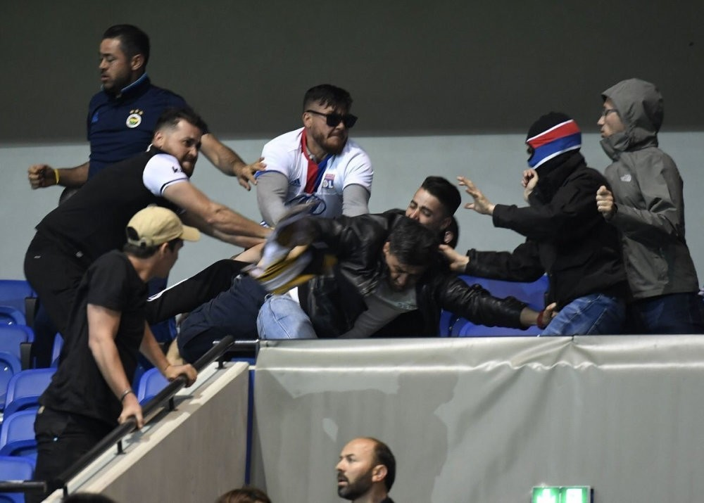 Lyonu2019s fans were so prepared that some of them wore masks before attacking the Turkish fans during the UEFA Europa League Quarter Final First Leg at Parc Olympique Lyonnais on Apr. 13.