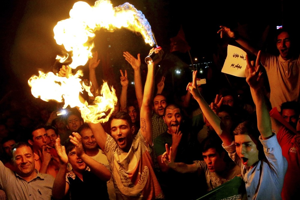 Iranians celebrate following a landmark nuclear deal in Tehran, Iran, July 14, 2015. Since becoming president early last year, Donald Trump has supported Israel and the Gulfu2019s anti-Iran agenda and has attacked the nuclear deal.