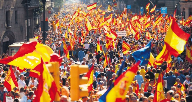 Thousands of people march to protest the Catalan government's push for secession from the rest of Spain, Barcelona, Oct. 8.