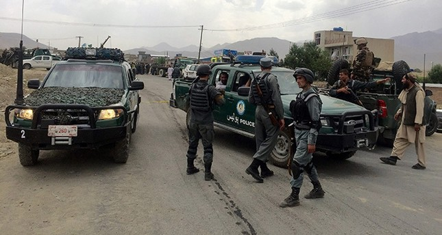 Afghan Police secure the scene of a suicide bomb attack that attacked a police convoy on the outskirts of Kabul, Afghanistan, 30 June 2016. (EPA Photo)