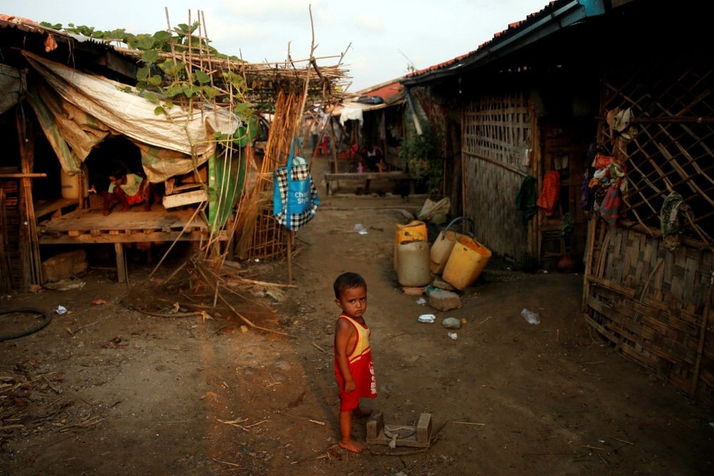 A Rohingya boy stands in a refugee camp outside Kyaukpyu in Rakhine state, Myanmar, May 18.