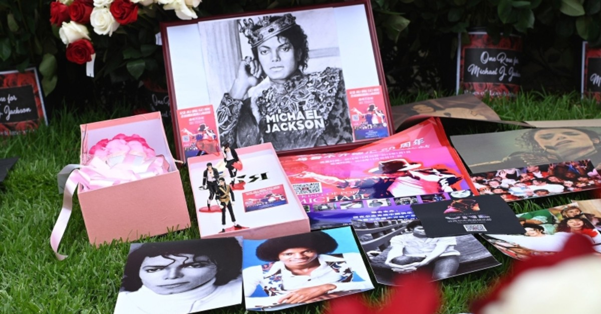 Pictures and flowers placed by fans gathered outside Michael Jackson's final resting place at the Holly Terrace mausoleum in Glendale, California to remember the King of Pop on the 10th anniversary of his death, June 25, 2019. (AFP Photo)