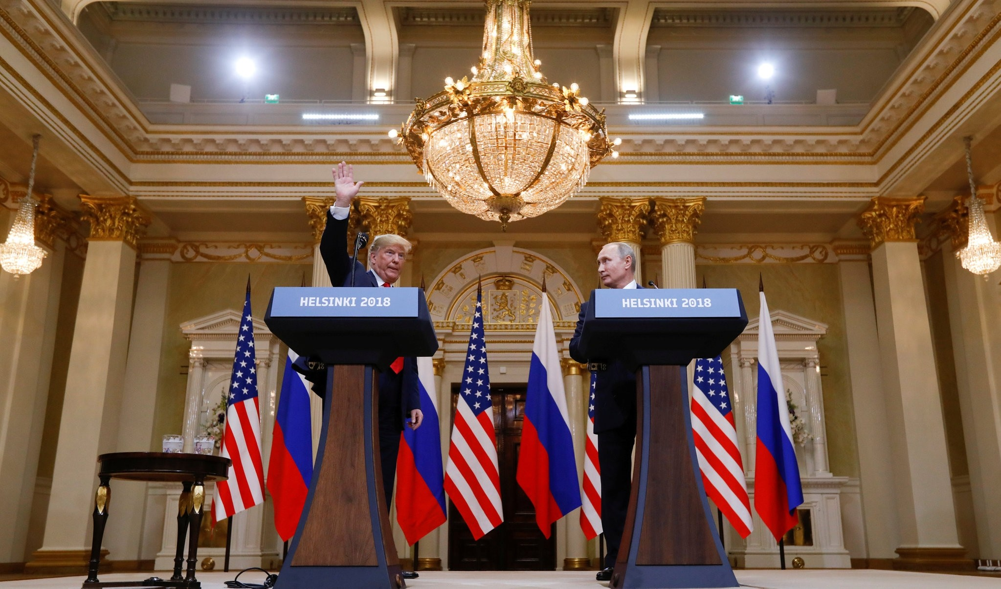 U.S. President Trump waves after a joint news conference with Russia's President Putin after their meeting in Helsinki, Finland, July 16.