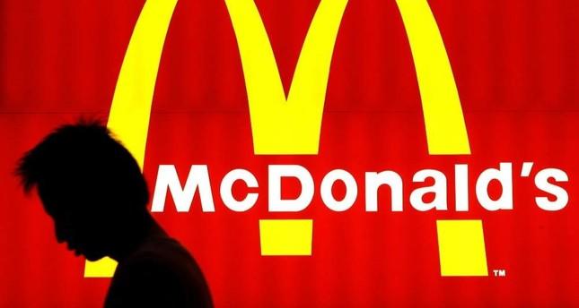 A man walks past a McDonald's billboard in Hong Kong. AFP File Photo