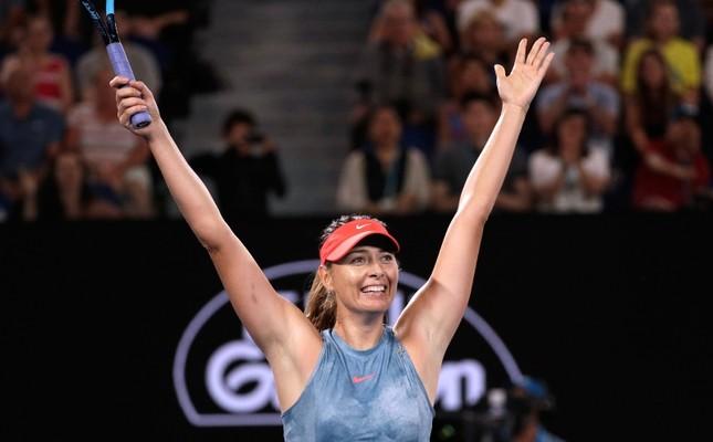 Russia's Maria Sharapova celebrates after defeating Denmark's Caroline Wozniacki in their third round match at the Australian Open tennis championships in Melbourne, Australia, Friday, Jan. 18, 2019. (AP Photo)