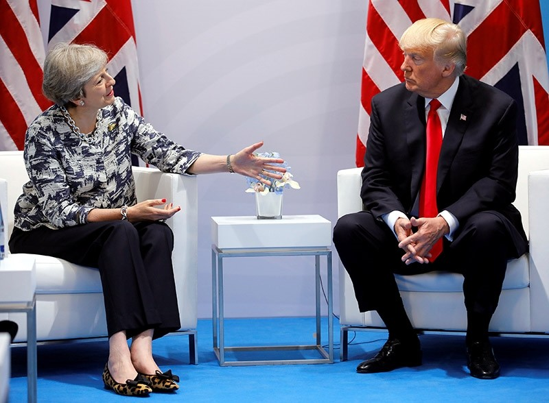 Britain's Prime Minister Theresa May talks with U.S. President Donald Trump during the G20 leaders summit in Hamburg, Germany July 8, 2017. (Reuters Photo)