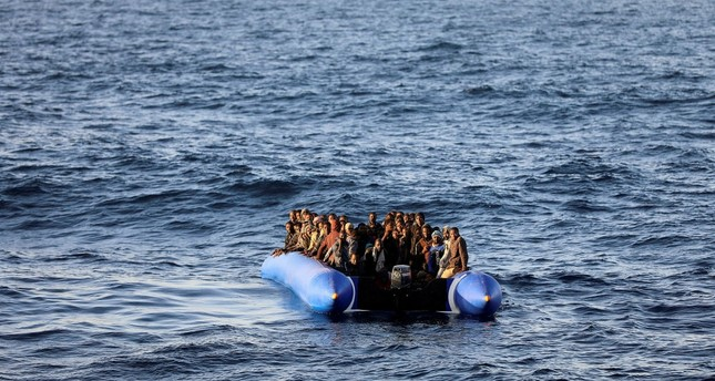 Migrants in a raft were rescued by the Libyan coast guards off the coast of Garabulli, Libya, Jan. 8.