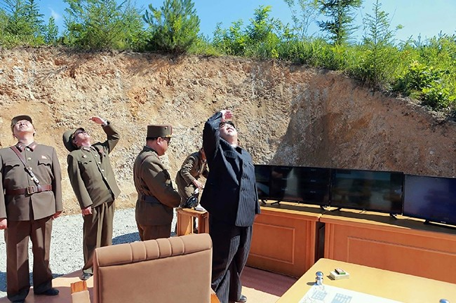 This picture taken on July 4, 2017 and released by North Korea's official Korean Central News Agency on July 5, 2017 shows North Korean leader Kim Jong-Un (R) inspecting the successful test-fire of ICBM Hwasong-14 at undisclosed location. (via AFP)