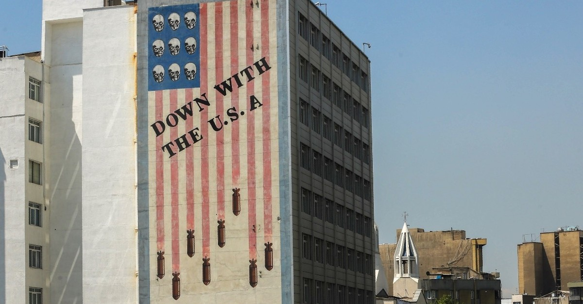 A large anti-U.S. mural covers the wall of a building in the center of the Iranian capital Tehran, on April 23, 2019.