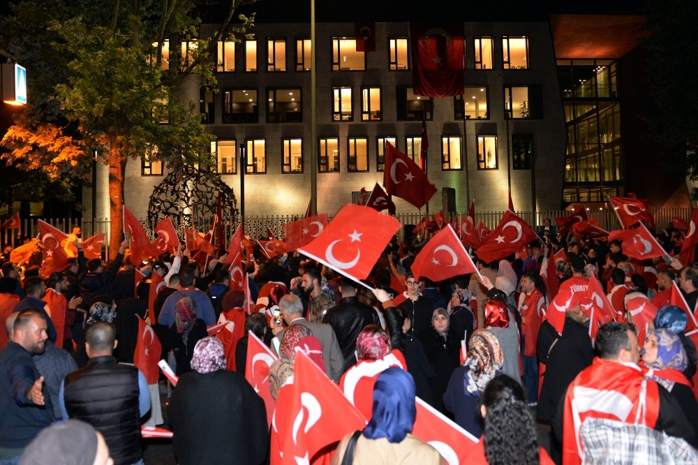 Turkish citizens at a pro-democracy rally outside Berlin embassy to mark the first anniversary of July 15 coup attempt. Germany is accused of harboring suspects involved in the bid.