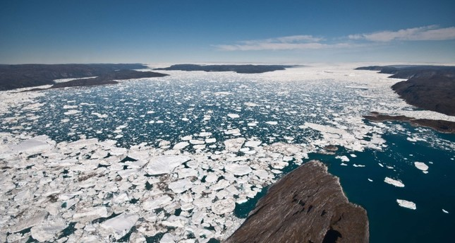 This undated photo courtesy of the University of Washington shows a view down the Ilulissat Fjord toward the terminus where Jakobshavn Isbrae rapidly discharges ice to the ocean. (AFP Photo / University of Washington / Ian Joughin)