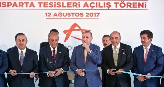 President Erdoğan, third from right, participated in the opening ceremony of two new beverage facilities belonging to Anadolu Group.