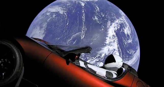 An image from video provided by SpaceX shows the company's spacesuit in Elon Musk's red Tesla sports car, which was launched into space during the first test flight of its Falcon Heavy rocket on Tuesday.