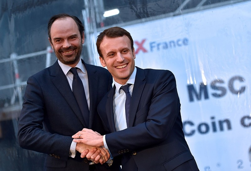 This file photo taken on February 1, 2016 shows French President Emmanuel Macron (R) shaking hands with mayor of Le Havres Edouard Philippe during the MSC Meraviglia cruise ship coins ceremony (AFP Photo)