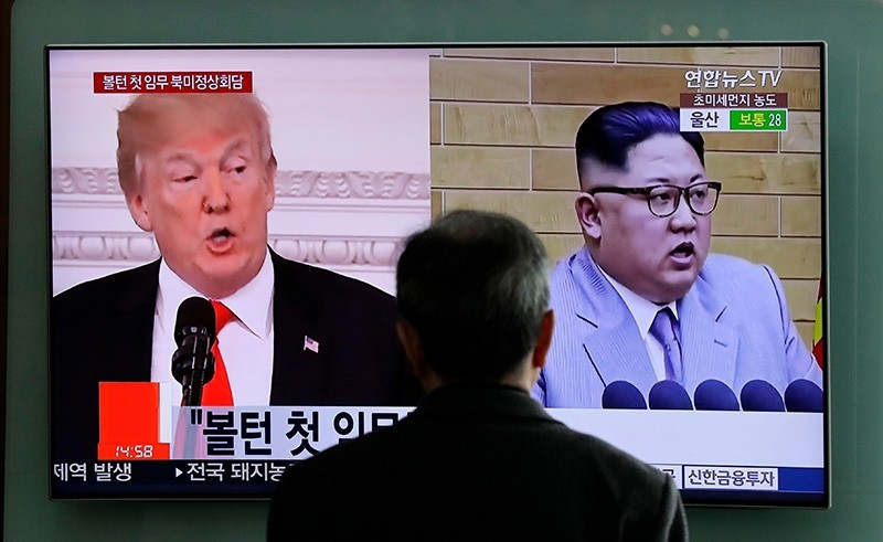 In this March 27, 2018, file photo, a man watches a TV screen showing file footages of U.S. President Donald Trump, left, and North Korean leader Kim Jong Un, right, during a news program at the Seoul Railway Station in Seoul, South Korea. (AP Photo)