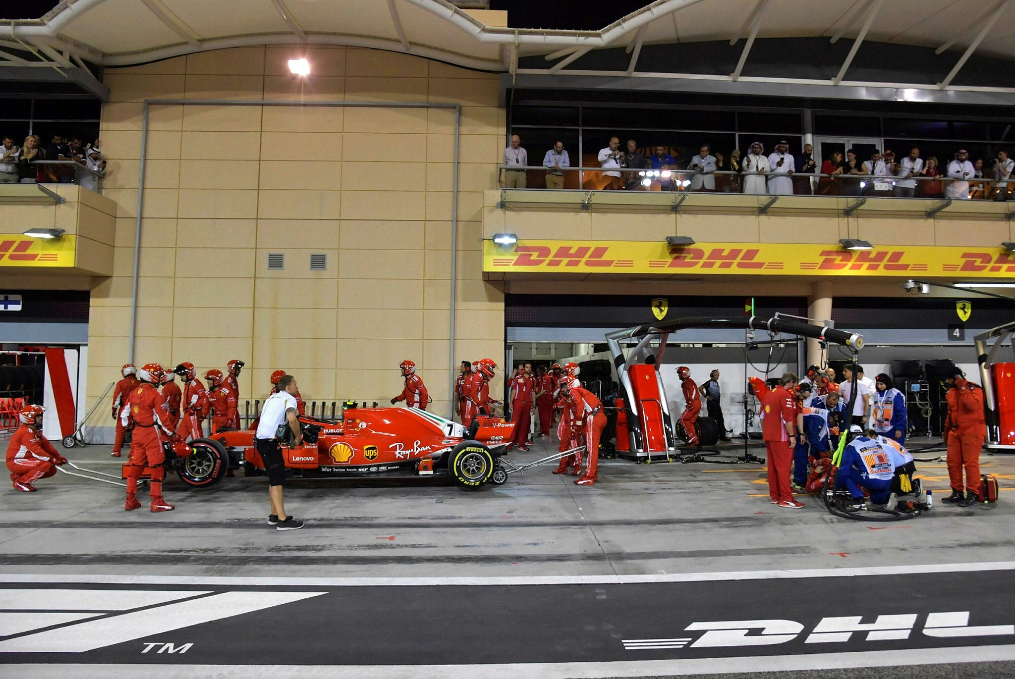 Ferrari team mechanic was taken to the hospital for treatment after being struck by Kimi Raikkonen's car during a botched tire change during the Bahrain Grand Prix on Sunday. (AFP Photo)