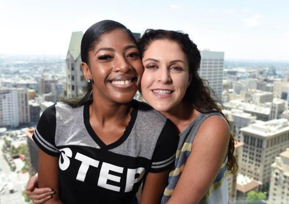 Director Amanda Lipitz and cast member Cori Grainger (L) pose together.