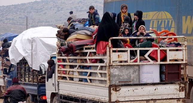 Civilians flee the endless attacks of the Assad regime and Russia in Syria's Idlib de-escalation zone. AA Photo