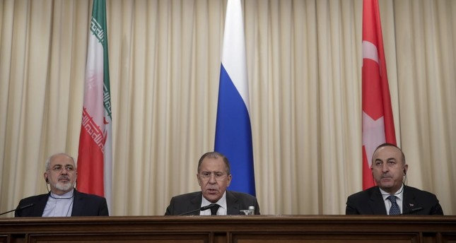 Iranian Foreign Minister Mohammed Javad Zarif (L), Russian Foreign Minister Sergey Lavrov (C) and Turkey's Foreign Minister Mevlüt Çavuşoğlu at a joint news conference after their talks of in Moscow.