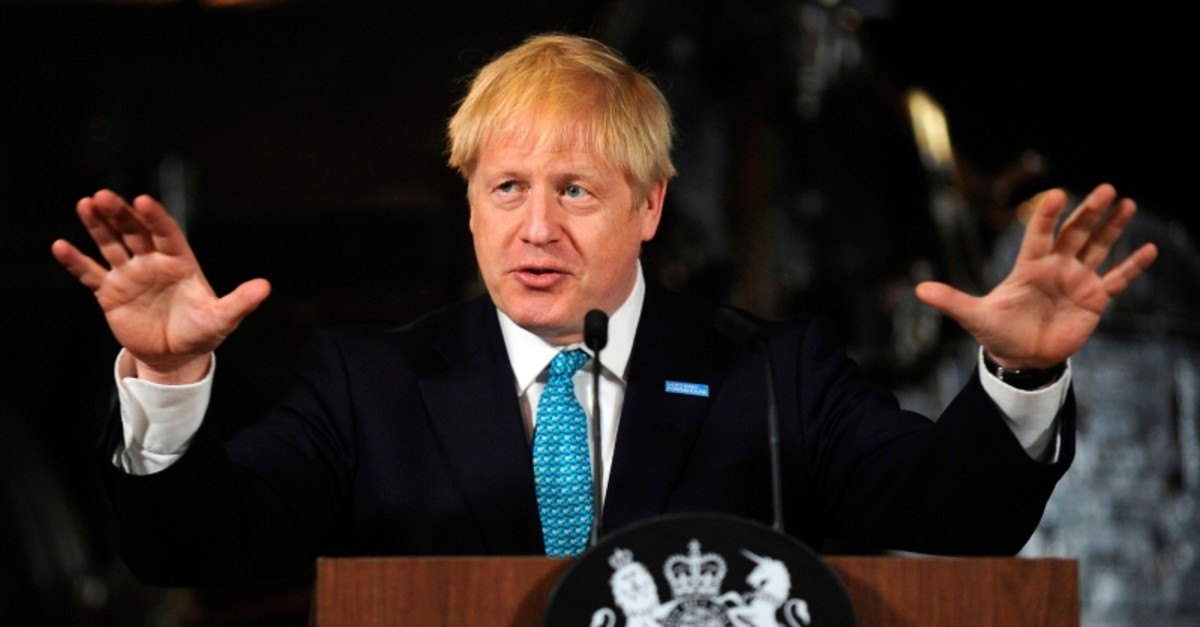 Britain's Prime Minister Boris Johnson gestures as he gives a speech on domestic priorities at the Science and Industry Museum in Manchester, northwest England on July 27, 2019. (AFP Photo)