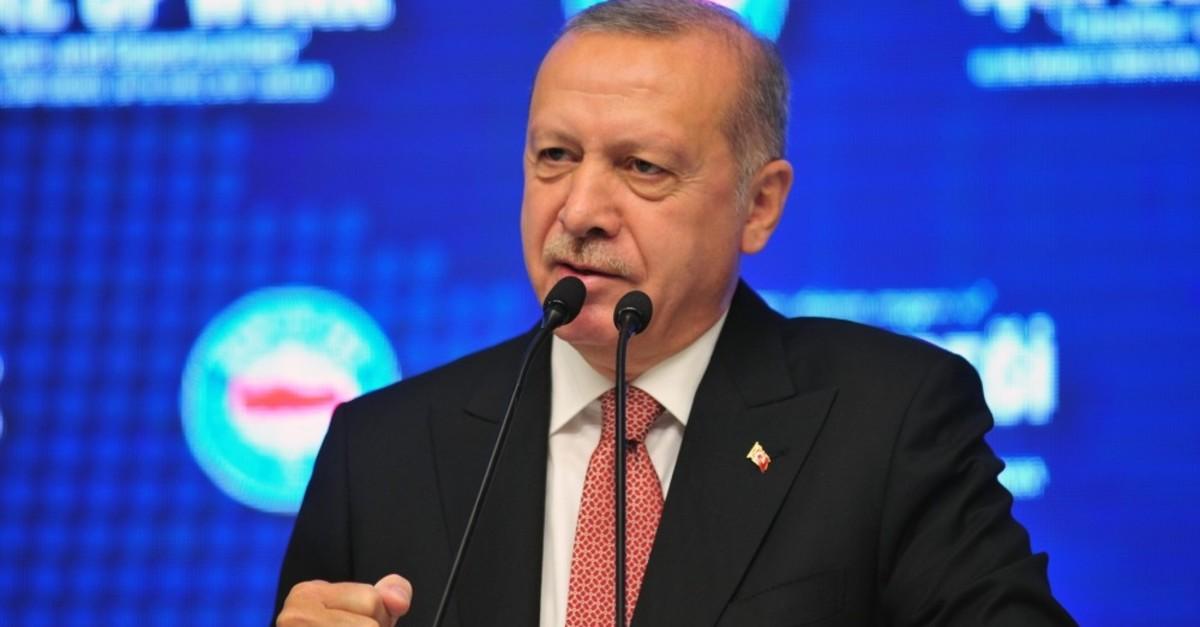 President Recep Tayyip Erdou011fan speaks at the international labor conference organized by the Confederation of Public Servants Trade Unions (Memur-Sen), Ankara, April 18, 2019.