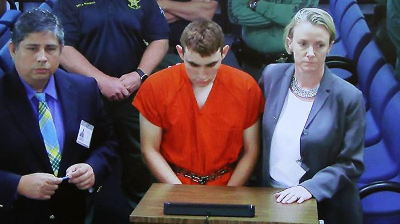 School shooter Nikolas Cruz (C) makes a video appearance in Broward County court before Judge Kim Theresa Mollica, Fort Lauderdale, Florida, February 15, 2018. (EPA Photo)