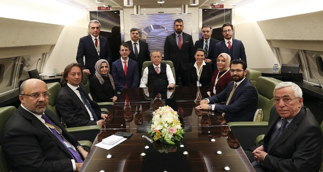 President Recep Tayyip Erdoğan accompanied by journalists on the presidential plane returning from Russia, April 9, 2019.