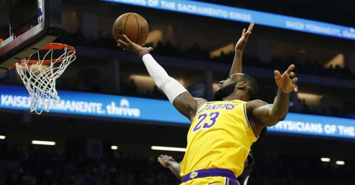 James goes to the basket during an NBA game against Sacramento Kings, Feb. 1, 2020. (AP Photo)