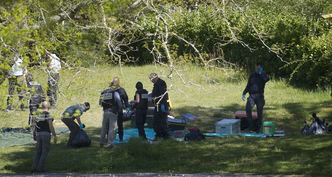 Police forces and demining team officers identify weapons handed by Basque separatist group ETA on April 8, 2017. AFP PHOTO