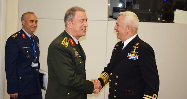 Chief of Staff Gen. Hulusi Akar greets Greek counterpart Admiral Evangelos Apostolakis in Brussels. (IHA Photo)
