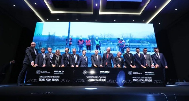Industry and Technology Minister Mustafa Varank, seventh from right, along with WABCO representatives, attended the groundbreaking ceremony for the company's new facility in the industrial province of Sakarya, Jan. 29, 2020. AA Photo