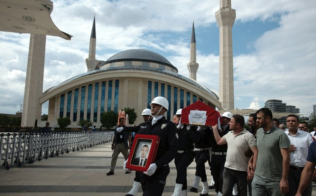 A police honor guard carries the coffin of Osman Köse, a 38-year-old Turkish diplomat killed in Iraq, before his funeral prayers in Ankara, Turkey, July 18, 2019.