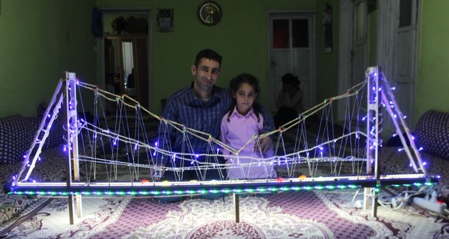 Yağmur Güder poses with the model bridge her father (left) built for her.