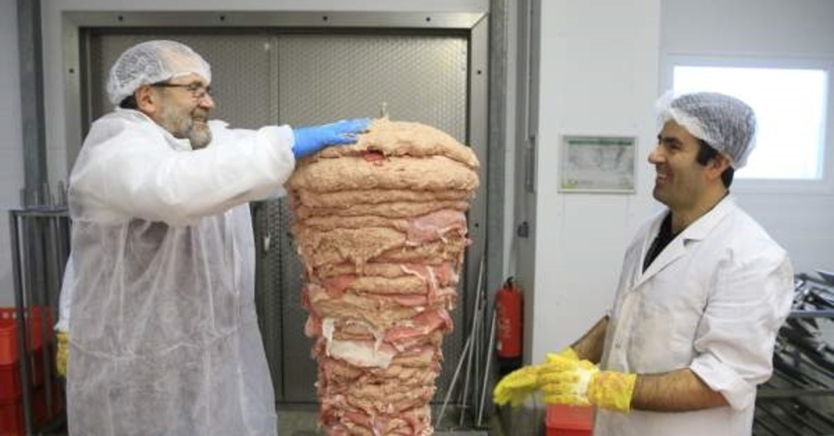 Hasan Babur (L) runs a successful du00f6ner kebab factory in Germany and exports to many European countries.