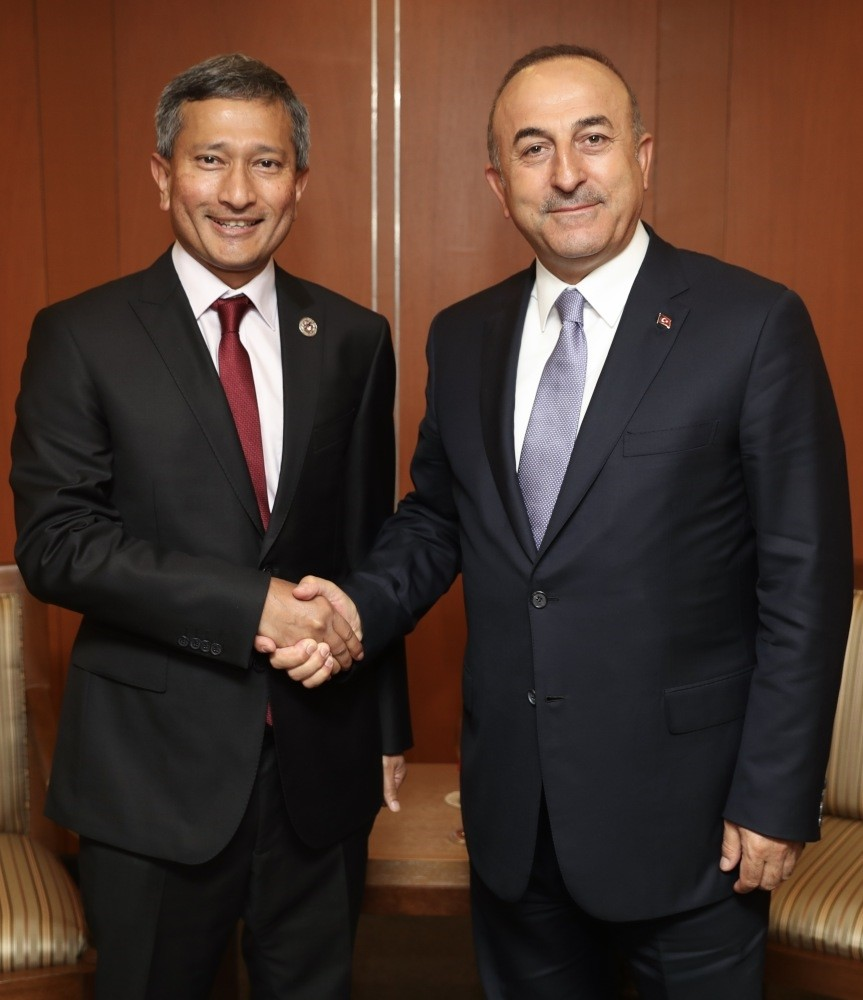 Foreign Minister Mevlu00fct u00c7avuu015fou011flu (R) had a meeting with the foreign ministers of several Asian countries, including Foreign Minister of Singapore Vivian Balakrishnan (L), during the Association of Southeast Asian Nations (ASEAN).