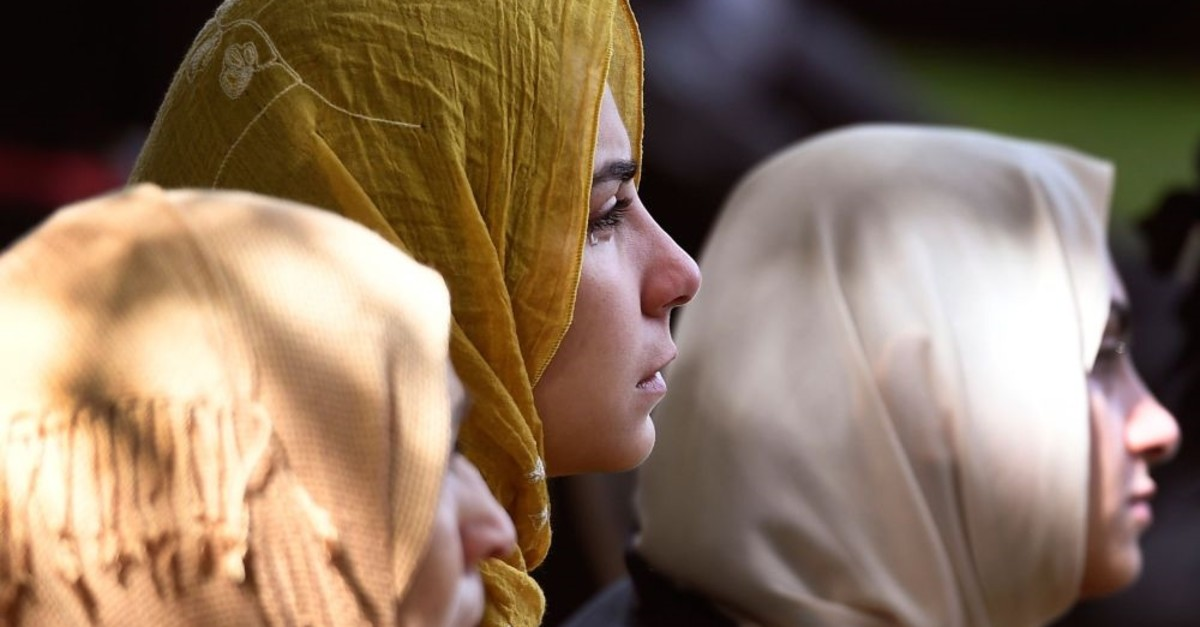 Members of the public look on during congregational Friday prayers and the two minutes of silence held for victims of the twin mosques massacre in Christchurch, March 22, 2019.