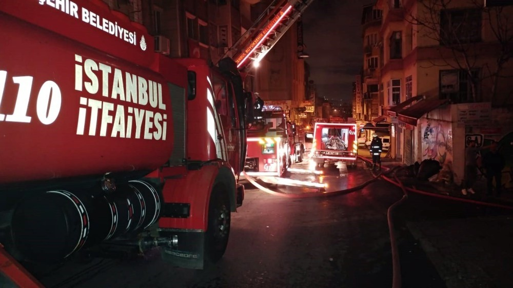 Istanbulu2019s firefighters respond to a fire at night.