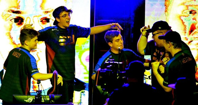 Team eUnited celebrates after they defeated 100 Theives at the Call of Duty World League Championship, California, Aug. 16.