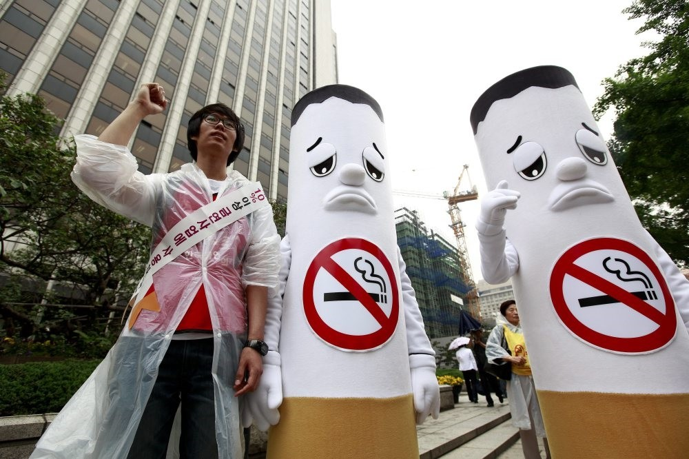 Anti-smoking activists protest tobacco products during a rally in South Korea on the International No Tobacco Day, May 31.