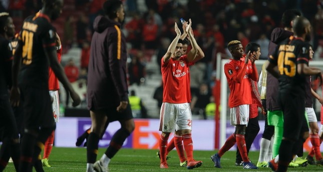Benfica players applaud fans at the end of match as Galatasaray players walk by, Feb. 21, 2019.