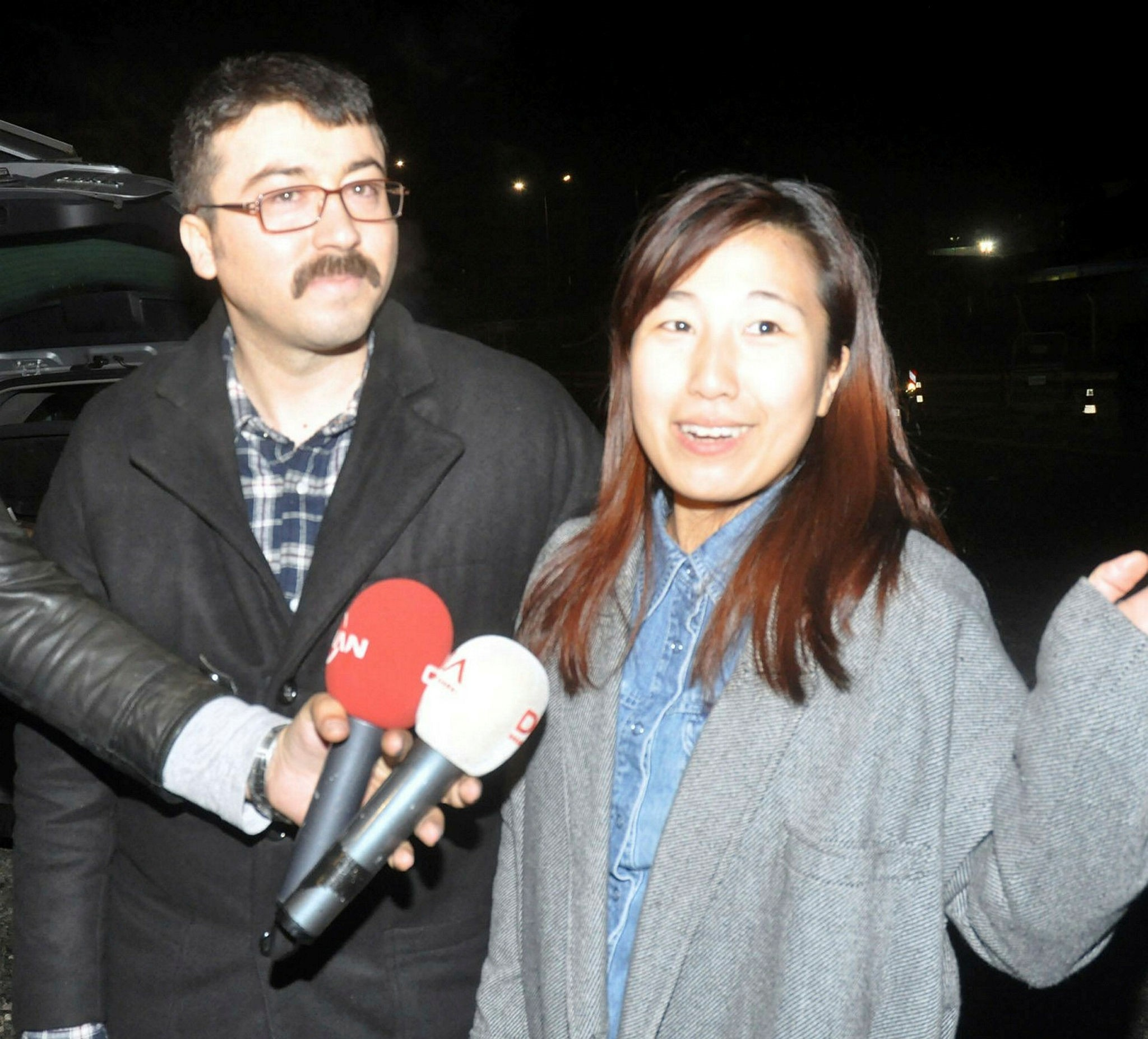 Fugitive Hu00fcseyin Korkmaz (L) and his wife after being released in Turkey
